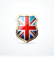 gold shield with great britain flag elements vector image