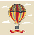 Vintage hot air balloon in the sky with clouds vector image