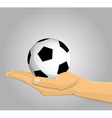 Hand holding a soccer ball vector image vector image