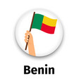 benin flag in hand round icon vector image
