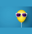 blue background with yellow balloon in sunglasses vector image vector image