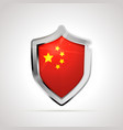 china flag projected as a glossy shield on a white vector image