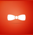 bow tie icon isolated on orange background vector image