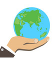 men hand is holding small earth vector image vector image