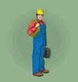 an electrical worker in overalls and a helmet vector image