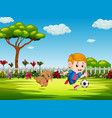 boy playing soccer in the yard with his dog vector image
