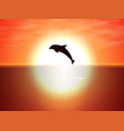 dolphin jumping over the water of the sunset sun vector image