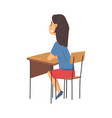 girl sitting at desk in classroom and vector image vector image