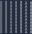set of white patterned lines on a dark vector image
