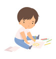 cute boy sitting on floor and drawing sun vector image vector image