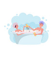 young couple in shower caps taking a bath girl vector image