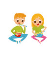 cheerful little kids sitting on floor and eating vector image