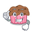 thumbs up cartoon chocolate muffins ready to eat vector image