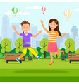 boy and girl jumping with hands up at city park vector image