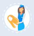 stewardess presenting how to use life vest vector image
