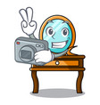 photographer dressing table mascot cartoon vector image