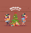 couple bring stack of present boxes to christmas vector image vector image