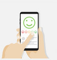 hand holding mobile phone with feedback emoticons vector image