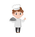 smiling boy in cook uniform with dish vector image vector image