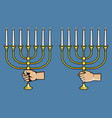 hand grab jewish candle stick vector image vector image