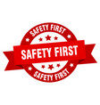 safety first ribbon safety first round red sign vector image vector image
