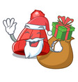 santa with gift beanie hat isolated on the mascot vector image