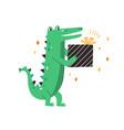 cute green crocodile holding birthday gift baby vector image vector image