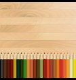 pencils multicolored autumnal wooden background vector image vector image