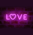 neon love word on the wall vector image vector image