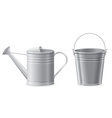 metal bucket and watering can vector image vector image