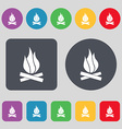 A fire icon sign A set of 12 colored buttons Flat vector image