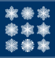 white snowflakes silhouettes isolated on dark blue vector image vector image