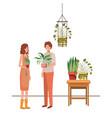 couple with houseplant on macrame hangers vector image vector image
