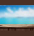 wood table top and blurred blurred beach