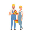 man and woman builders in blue overalls vector image
