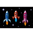 Three brightly colored rockets in outer space vector image vector image