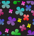 multi-colored clover on a black background vector image