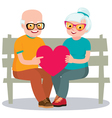 Senior married couple sits on a bench