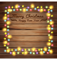 Christmas lights on wooden boards and chalkboard vector image