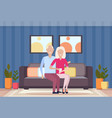 senior couple embracing sitting on couch happy vector image