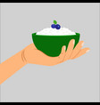 hand holding cottage cheese with berry vector image