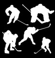 white silhouettes of hockey players on a black vector image vector image