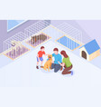 pet adopt family plays with dog at animal shelter vector image