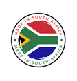 made in south africa round label vector image