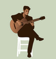spanish guitarist playing flamenco sitting on a vector image vector image