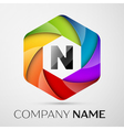 N Letter colorful logo in the hexagonal on grey vector image vector image