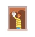 smiling teenager boy washing window with rag vector image vector image