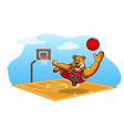 happy bear playing basketball on the field vector image