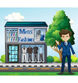 A business owner outside the mens fashion shop vector image