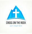cross on rock logo vector image vector image